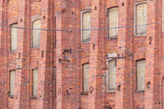 Windows in a row on facade of industrial building. Several windows in row on brick facade of industrial building angle view, St. Petersburg, Russia Royalty Free Stock Image
