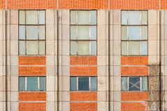 Windows in a row on facade of industrial building. Several windows in row on facade of industrial building front view, St. Petersburg, Russia Royalty Free Stock Photo