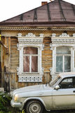 Windows on the Russian house. Russian house carved windows in the village and Volga car Royalty Free Stock Photography