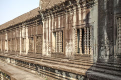 The windows of second enclosure, Angkor, Siem Riep, Cambodia. The lake in front of the Angkor Wat where tourist commonly stand here to take picture of the Stock Images