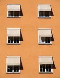 Windows with shades Royalty Free Stock Photo
