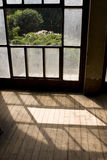 Windows' shadow. Shadows comes out from a an old window on the wooden floor Royalty Free Stock Image