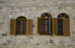 Windows with shuttered  in stone wall Royalty Free Stock Image