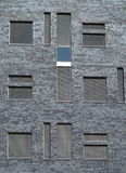 Windows with shutters in city gray wall pattern Stock Images