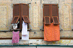 Windows, Shutters and Laundry in Italy Royalty Free Stock Photography