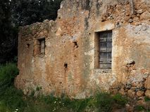 Windows In Old Stone House. Windows with shutters in old stone house on the island of Crete Greece Stock Image