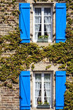 Windows with shutters. A typical French facade with windows and blue shutters in Brittany, France Royalty Free Stock Photos