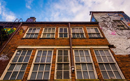 Windows on the side of a building in Graffiti Alley, Baltimore, Royalty Free Stock Images