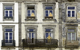 Windows with silhouettes. Detail of a facade in the city of Porto, Portugal Stock Photography