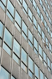 The windows of a skyscraper. The windows in a modern building built of glass and steel Stock Photos