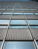 The windows of a skyscraper. The windows in a modern building built of glass and steel Stock Image