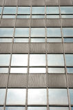 The windows of a skyscraper. The windows in a modern building built of glass and steel Royalty Free Stock Images