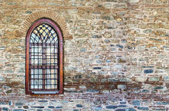 Windows and stone walls Stock Photos