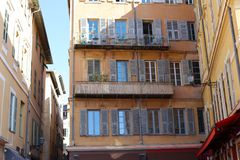 Windows in the streets of Nice French riviera, mediterranean coast, Saint-Tropez, Cannes and Monaco. Blue water and luxury yachts. Windows in the streets of Royalty Free Stock Photo