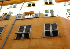 Windows in the streets of Nice French riviera, mediterranean coast, Saint-Tropez, Cannes and Monaco. Blue water and luxury yachts. Windows in the streets of Royalty Free Stock Images