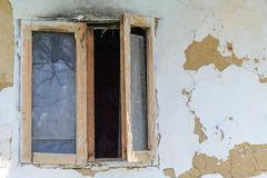Windows to a abandoned house. Windows opened to a abandoned house Stock Photos