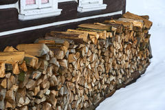 Windows of a traditional country cottage house with firewood logs Stock Images