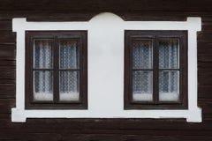 Bziny village in Orva region. Windows of a traditional log cabin, Orava region, Slovakia royalty free stock photo
