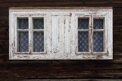 Chlebnice village in Orva region. Windows of a traditional log cabin, Orava region, Slovakia royalty free stock photos