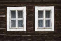 Chlebnice village in Orva region. Windows of a traditional log cabin, Orava region, Slovakia royalty free stock images