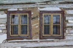 Velicna village in Orva region. Windows of a traditional log cabin, Orava region, Slovakia royalty free stock photos