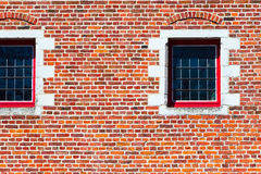 Windows of traditional medieval house exterior on red brick wall, Belguim Royalty Free Stock Images