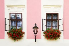 Windows. Two old open window with flowers and lamp Royalty Free Stock Image