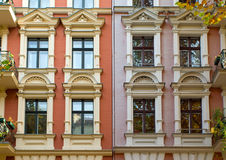 Windows of two rehabilitated townhouses Stock Photos