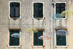 Windows and umbrellas Royalty Free Stock Photography