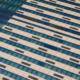 Windows of under construction high-rise building. Front view of modern glass and concrete exterior of high rise building. As abstract diagonal background royalty free stock photo