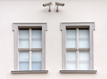 Windows under surveillance Stock Photography