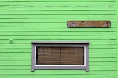 Windows venetian blind wooden green wall Royalty Free Stock Photo