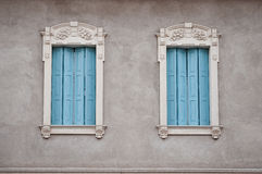 Windows in Veneto. Windows in Villafranca, Veneto Italy,... very interesting gypsum work around the blue covers fro Windows Royalty Free Stock Photography