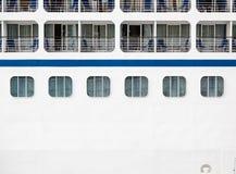 Windows and Verandas on Side of Ship. Windows, verandas and decks on the side of a massive luxury cruise ship Royalty Free Stock Image