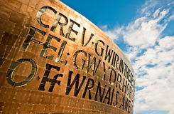 Windows of Wales Millenium Centre. The face of the Wales Millenium Centre building is emphasised by a spectacular set of windows, made in the form of letters Royalty Free Stock Image