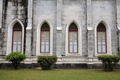 Windows and wall of Catholic church Stock Photos