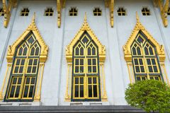 Windows and wall with garden decoration in wat Sothon Wararam Wo. Rawihan, the landmark of Chachoengsao province, Thailand royalty free stock photos