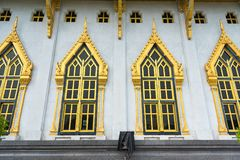 Windows and wall with garden decoration in wat Sothon Wararam Wo. Rawihan, the landmark of Chachoengsao province, Thailand stock photography