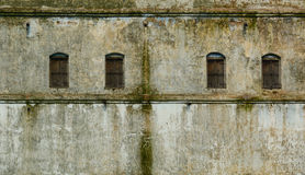 Windows in the wall of the old building Stock Image