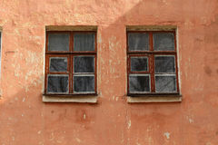 Windows on the wall of an old house Royalty Free Stock Photo