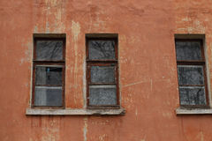 Windows on the wall of an old house Royalty Free Stock Photos