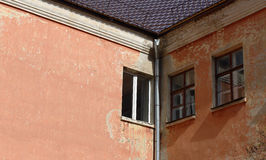 Windows on the wall of an old house Stock Images