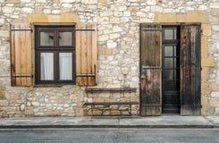 Windows on wall stone. Near a door Royalty Free Stock Photography