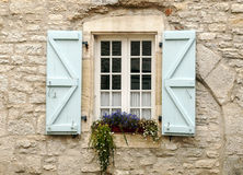 Windows on wall stone Stock Images