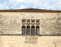 Windows on wall stone. On a sunny day Stock Photo