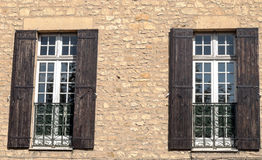 Windows on wall stone. With wooden shutters Stock Photos