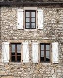 Windows on wall stone Stock Photography