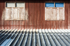 Windows on the wall. Two set of wood windows on wood wall and the roof Royalty Free Stock Photography
