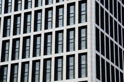 Windows and Walls. This was the exterior surface of a modern building. White walls and dark blue windows Royalty Free Stock Photo