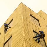 Two window washers at work. royalty free stock photography